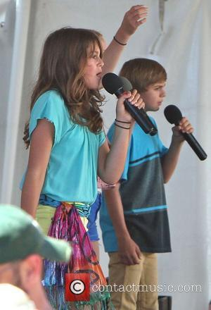Cindy Crawford's daughter Kaia Jordan Gerber performing on stage at the 31st Annual Malibu Kiwanis Chili Cook-Off  Malibu, California...