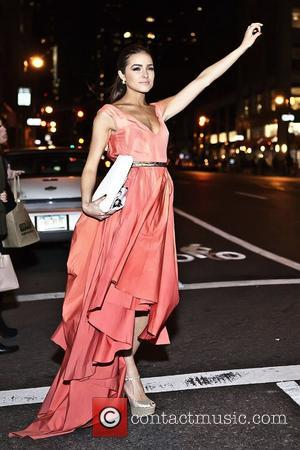 Miss USA 2012 Olivia Culpo hailing a taxi after attending City Harvest's 18th Annual Bid Against Hunger Tasting Event at...