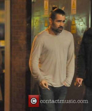 Colin Farrell Colin Farrell looking disheveled and sporting a full beard is seen smoking and enjoys a night out with...