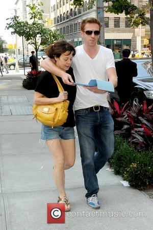 Helen McCrory and Damian Lewis British actor holding his iPad as he leaves his Manhattan hotel with his wife New...