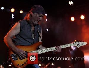 Deep Purple's Roger Glover performing on stage at the O2 Arena as part of Deep Purple with a 32 piece...