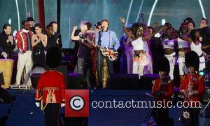 Paul McCartney performs with Will.i.am, Cheryl Cole, Annie Lennox and others at The Diamond Jubilee Concert at Buckingham Palace. London,...