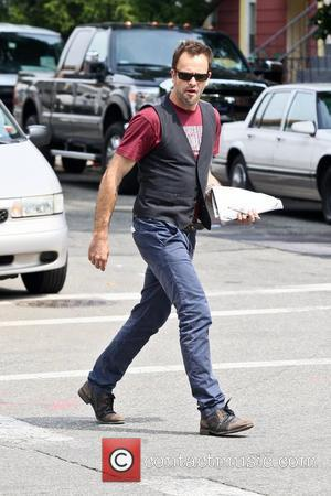 Jonny Lee Miller on the set of his new CBS television series 'Elementary' in Greenpoint, Brooklyn. New York City, USA...