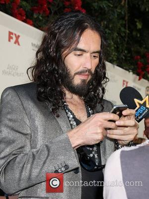 Russell Brand Phones Producer's Dad During Interview