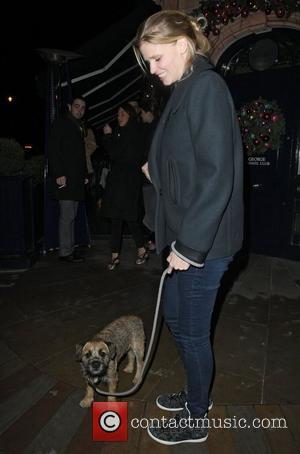 Pregnant Lara Stone Hits Streets of London With Bert The Dog