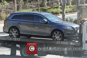 Heidi Klum's Audi Q7 car is towed from the gated community where she lives. Klum and husband Seal have recently...