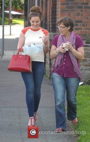 Helen Flanagan and her mother leaving Helen's sister Jane's dress-making studio's open day with a box of cupcakes Manchester, England...