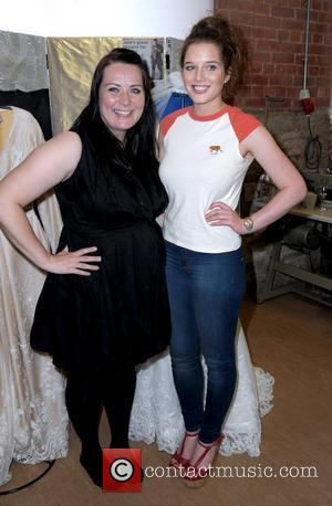 Helen Flanagan with her sister Jane Flanagan attending Jane's dress-making studio's open day. Helen watches her sister put the final...