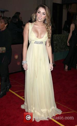 Miley Cyrus at the CNN Heroes: An All-Star Tribute at The Shrine Auditorium. Los Angeles, California - 11.12.11