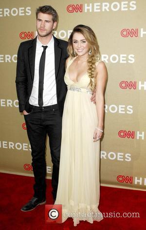 Miley Cyrus, Liam Hemsworth CNN Heroes: An All-Star Tribute at The Shrine Auditorium. Los Angeles, California - 11.12.11