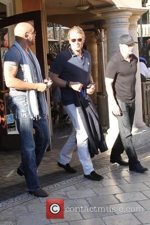 Dolph Lundgren and friends are seen walking through The Grove in West Hollywood West Hollywood, California - 26.01.12