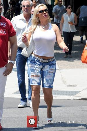 Coco Austin shopping with her husband in Soho during a heat wave in Manhattan New York City, USA - 21.06.12