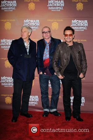 Adam Clayton and Bono 'Michael Jackson The Immortal World Tour' European Premiere at the O2 arena - Arrivals London, England...