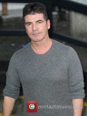 Simon Cowell's Embarrassing Secret Revealed By Holden