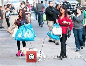 Pregnant Snooki Practises Parenting With Baby Doll