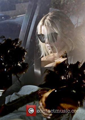 New mum Jessica Simpson  is photographed in her car as she leaves her personal trainer's house. Los Angeles, California...