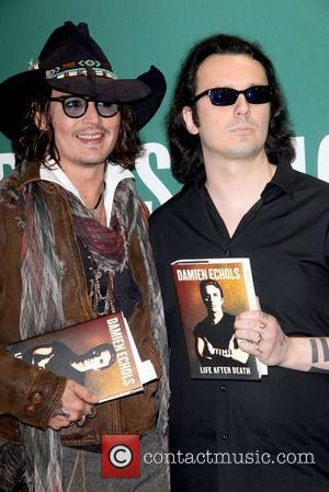 Johnny Depp (L) and Damien Echols attend Damien Echols In Conversation With Johnny Depp at Barnes & Noble Union Square...