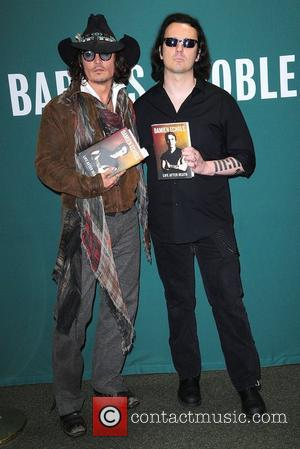 Johnny Depp and Damien Echols Damien Echols in Conversation with Johnny Depp at Barnes & Noble Union Square New York...