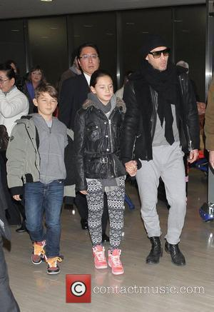 Jude Law and his children Iris and Rudy arrive at Narita International Airport to promote his new film Sherlock Holmes:...