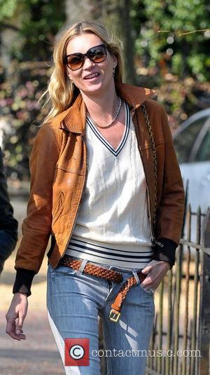 Kate Moss  leaving her new house with her belt undone and her trouser zip open London, England - 21.03.12