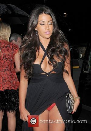 Cara Kilbey suffers a wardrobe malfunction while leaving the launch party for website 'You Gossip', held at the Red Bar,...