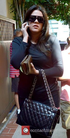 Khloe Kardashian talking on her cell phone as she runs errands in Beverly Hills Los Angeles, California - 22.08.12