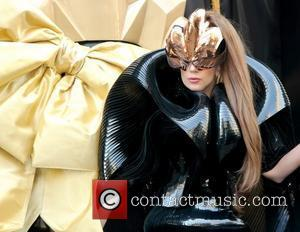 Lady Gaga arrives at Macy's Herald Square for her 'Fame' fragrance launch in a horse-drawn carriage, designed to resemble the...