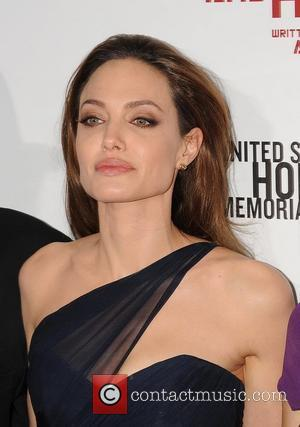 Angelina Jolie Got Globes News On Dentist Trip