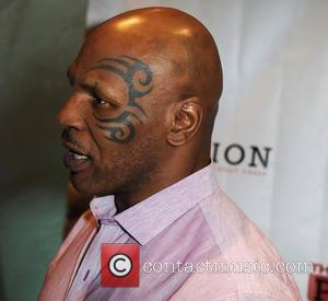 Mike Tyson Walked In On Estranged Wife Making Out With Brad Pitt