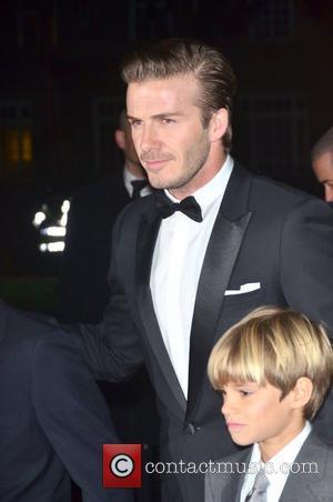 David Beckham Furious After Family Christmas Card Leaks