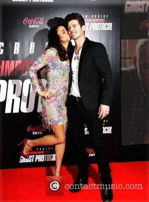 Paula Patton and Robin Thicke  New York Premiere of ''Mission: Impossible - Ghost Protocol'' at the Ziegfeld Theatre -...