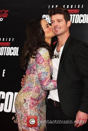 Paula Patton and Robin Thicke New York Premiere of ''Mission: Impossible - Ghost Protocol'' at the Ziegfeld Theatre - Arrivals...