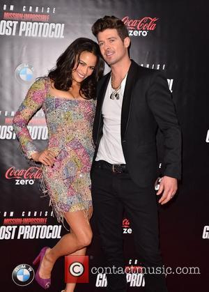 Paula Patton, Robin Thicke New York Premiere of ''Mission: Impossible - Ghost Protocol'' at the Ziegfeld Theatre - Arrivals New...