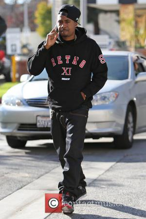 Nas talking on his mobile phone as he walks along Fifth Avenue in Beverly Hills towards Saks where ex-wife Kelis...