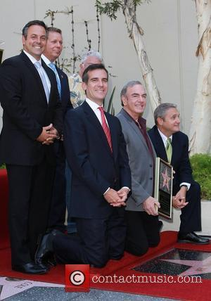 Eric Garcetti, Randy Newman, Neil Diamond Neil Diamond is honoured with a star on the Hollywood Walk of Fame, held...