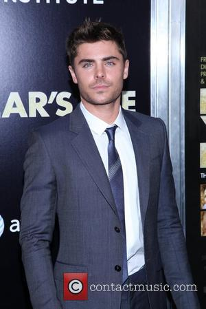 Zac Efron New York premiere of 'New Year's Eve' at the Ziegfeld Theatre - Arrivals New York City, USA -...