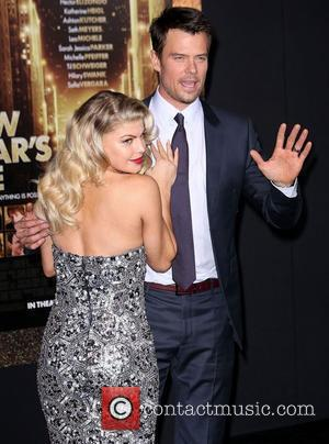 Josh Duhamel and Stacy Ferguson, aka 'Fergie' Los Angeles premiere of 'New Year's Eve' at Grauman's Chinese Theatre. Hollywood, California...
