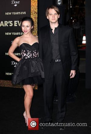 Jacob Saylor and guest Premiere of Warner Bros. Pictures' 'New Year's Eve' at Grauman's Chinese Theatre Hollywood, California - 05.12.11
