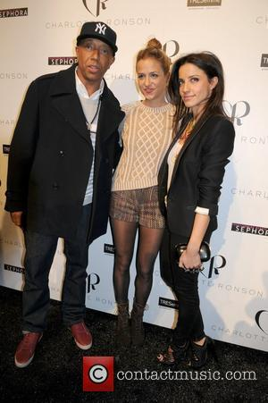 Russell Simmons Splits From Melissa George