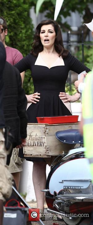 Nigella Lawson  seen filming an advert for Mail on Sunday in Hampstead London, England - 23.08.12