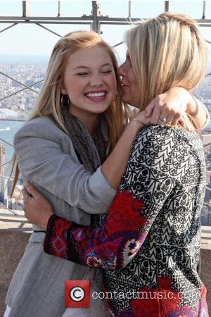 Olivia Holt with her mom Kim Holt Disney star Olivia Holt attends a photocall on the 86th-floor observation deck of...