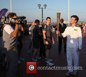 Matt Smith starts the second day of the Olympic torch relay tour of Wales Cardiff, Wales - 26.05.12