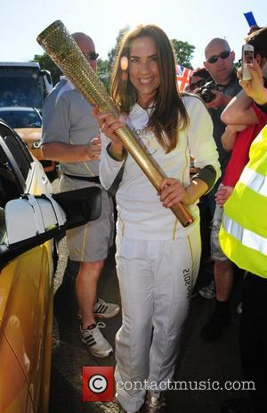 Melanie Chisholm carries the Olympic flame through Liverpool Liverpool, England - 01.06.12