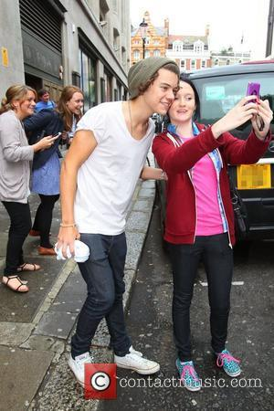 Harry Styles of One Direction leaving the Sony Music offices London, England - 18.07.12
