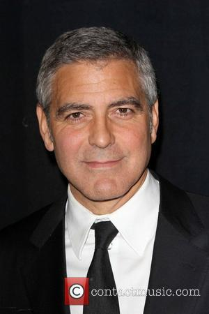 George Clooney Admits He Locks Stacy Keibler Up