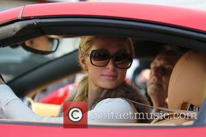 Paris Hilton  leaving a business meeting on Robertson Boulevard before driving off in a red Ferrari Los Angeles, California...