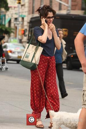 Actress Parker Posey  seen on her phone while walking her dog New York City, USA - 01.06.12