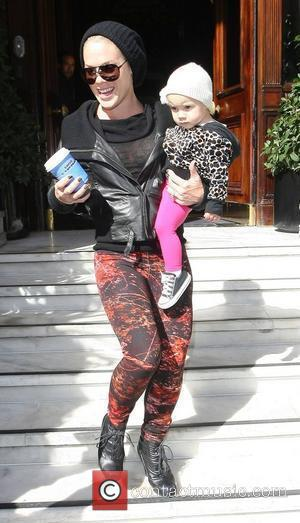 Pink, real name Alecia Moore leaves her hotel with daughter Willow Sage. London, England - 13.09.12