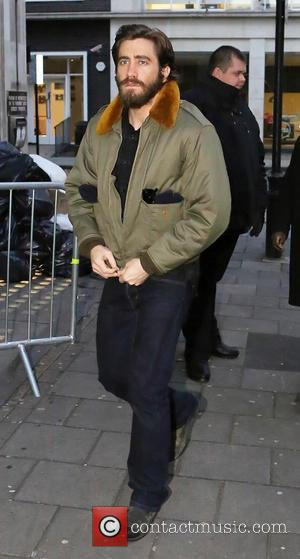 A bearded Jake Gyllenhaal arrives at the BBC Radio 1 studio, wearing an army green bomber jacket  Featuring: Jake...