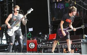 Jack Barakat and Alex Gaskarth, of All Time Low Reading Festival 2012 - Performances - Day Three Reading, England -...